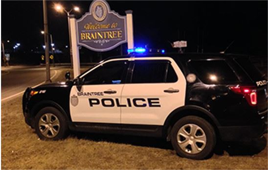 Braintree Police SUV parked in from of Welcome to Braintree sign