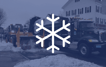 Snowflake over image of snowplow